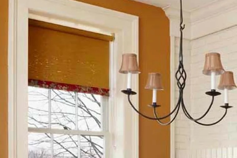 How to do it: Use natural fiber shades to highlight the transition between indoors and outdoors and help insulate windows. Estimated cost: 23-by-72-inch Bamboo Roman Shade, similar one shown, about $26 at Target.