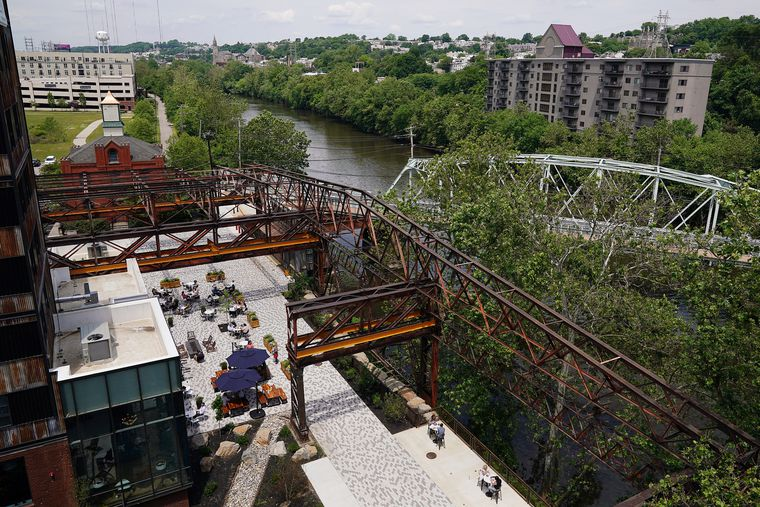 The ghostly outline of the 19th century Pencoyd Iron Works shades the new Schuylkill riverfront development in the Bala Cynwyd section of Lower Merion. The project, called Pencoyd Landing, offers spectacular views of the river, the Pencoyd Bridge, and Manayunk.