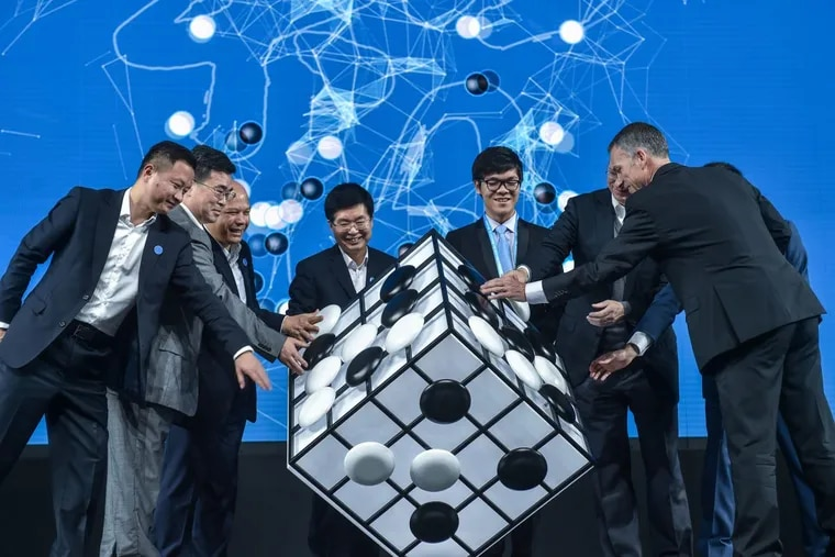Chinese Go player Ke Jie, third from right, and other guests attend the opening ceremony of the Future of Go Summit before a match between him and Google's artificial intelligence program AlphaGo. Nowe the feds want to use AI to comback child porn.