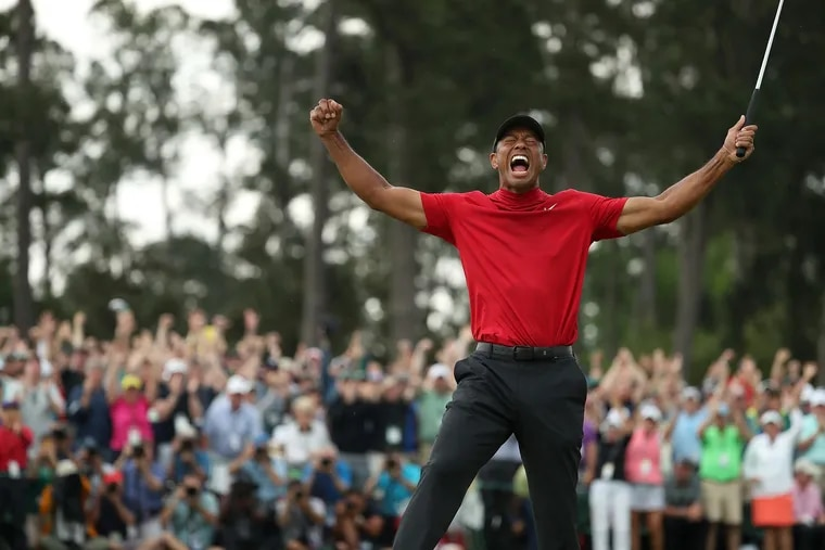 Tiger Woods celebrates his Masters victory at Augusta on Sunday.