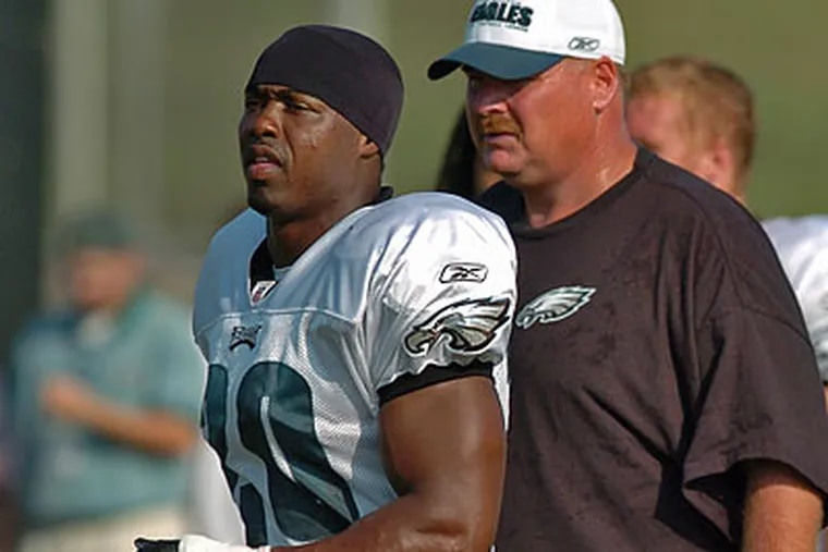 """""""To say I don't miss him on a daily basis, I used to enjoy seeing him and being around him,'' Andy Reid said Monday of Brian Dawkins.(Clem Murray/Staff file photo)"""