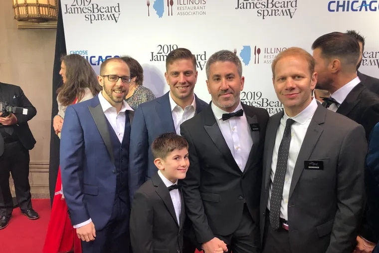 The crew from Zahav: owners Michael Solomonov and Steve Cook at right with chefs Andrew Henshaw (left) and Yehuda Sichel and Solomonov's son David.