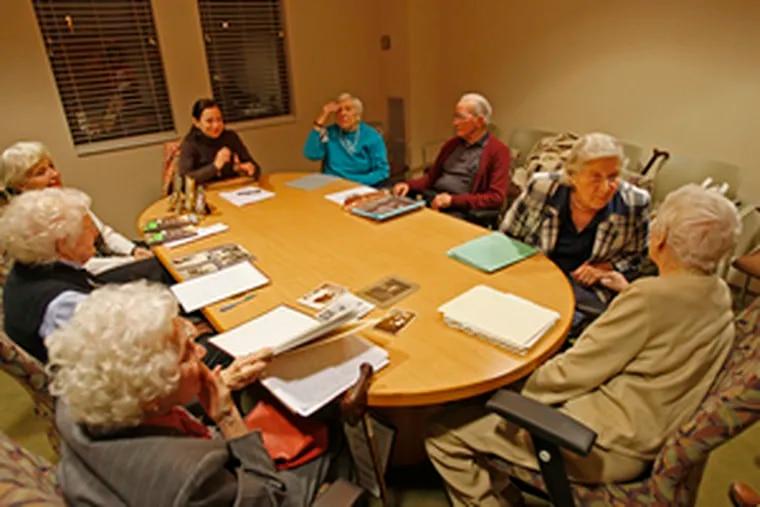 Bucks County writing coach Oana Nechita (at the head of the table) and autobiographers: from left, Minnetta Bancroft, Elaine Van Aken, Elly Kupferschmid, Emma Preiss, John Donohue, Betty Frey and Orphia Wirth.
