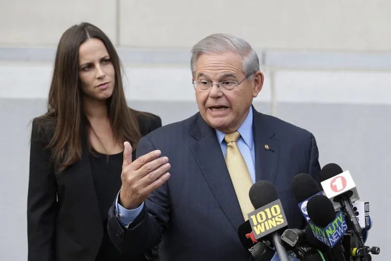 While his daughter Alicia Menendez looks on, Sen. Bob Menendez talk to reporters as he arrives to court in Newark, N.J., Wednesday, Sept. 6, 2017.  (AP Photo/Seth Wenig)
