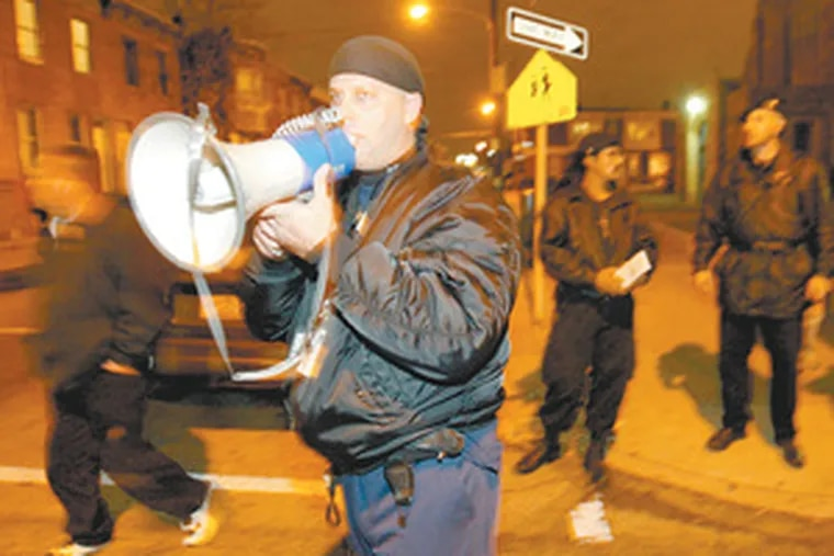 Bucceroni, a former part-time police officer, is pictured in 2005 at H and Ontario streets in Kensington calling for nonviolence.