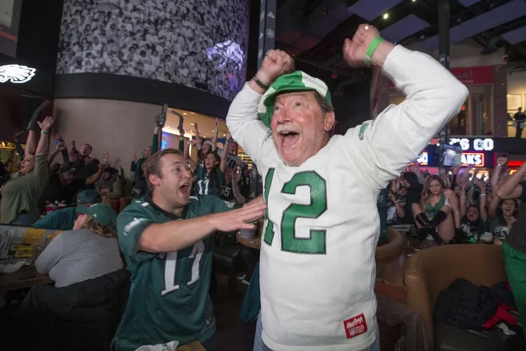Phil, left, and his father Robert DiTullio celebrate as the Eagles take an early lead over the Patriots in the Super Bowl LII.  They were part of 3,000 fans attending a sold-out Super Bowl Party at Xfinity Live!