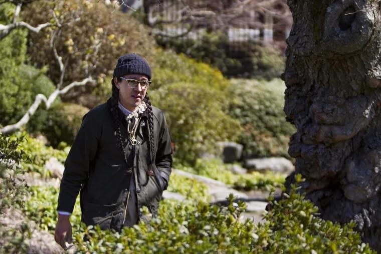 Head gardener Sandi Polyakov walks through the grounds at Shofuso Japanese House and Garden.