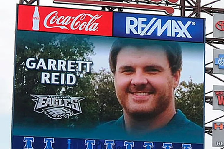 With Garrett Reid's picture on the scoreboard, the Phillies took time to honor the 29-year-old's memory before Sunday's game. (Michael Perez/AP)