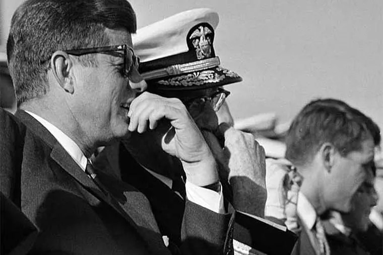 President John F. Kennedy watches the 1962 Army-Navy game at Municipal Stadium, which was renamed in his honor after his assassination. (Associated Press)