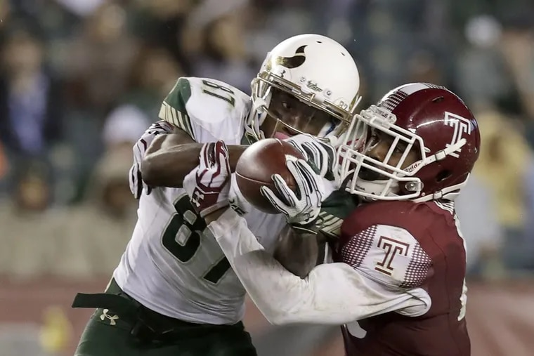 USF's Rodney Adams catches the football against Temple's Delvon Randall in the fourth-quarter on Friday, October 21, 2016 in Philadelphia. YONG KIM / Staff Photographer