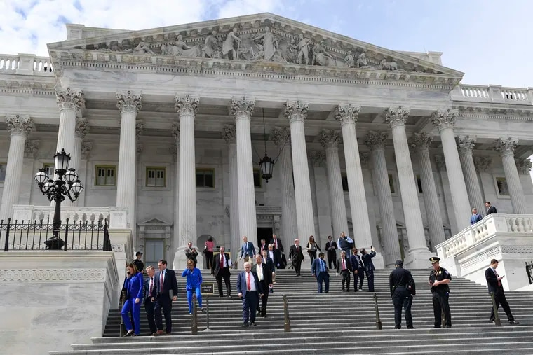 Members of the House of Representatives walking down the steps of Capitol Hill in Washington on March 27 after passing a coronavirus rescue package.