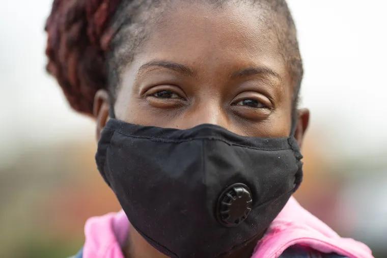 Marian Wilson, of Pennsauken, waits in line with her children for COVID-19 testing in Camden, NJ, on Wednesday, November 25, 2020.