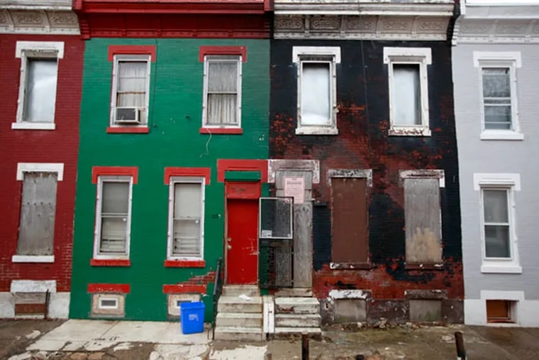The boarded-up rowhouse on the right, 1224 W. Harold St., in North Philadelphia, is the registered address of investor Edward Williams, who has been dead for 15 years. DAVID SWANSON / Staff Photographer