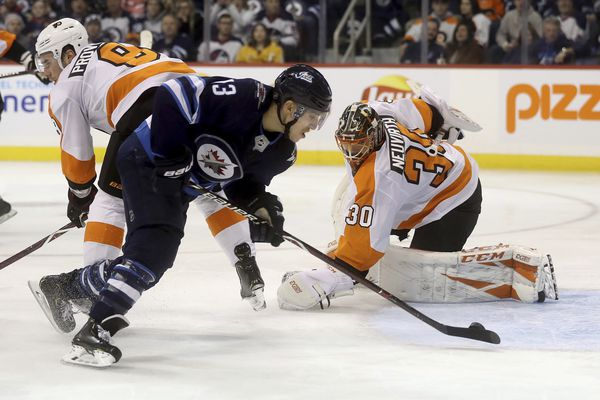 Michal Neuvirth, back from injury, gets shelled as Flyers lose to Winnipeg
