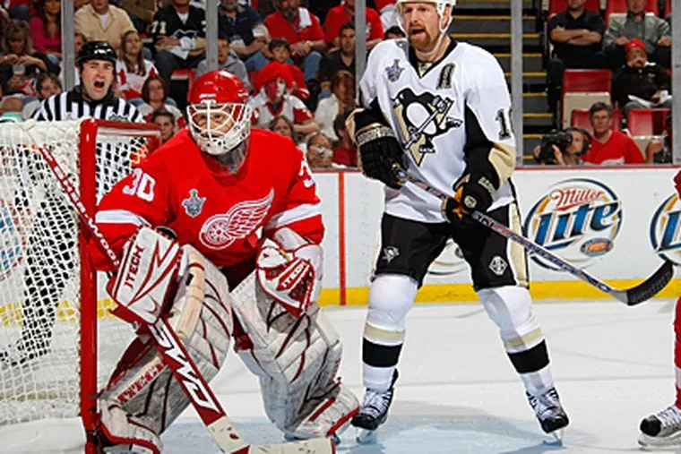 The Penguins' Gary Roberts calls for the puck in front of Red Wings' goaltender Chris Osgood during Game Two of the 2008 NHL Stanley Cup Finals at Joe Louis Arena on May 26, 2008. (Photo by Dave Sandford/Getty Images)