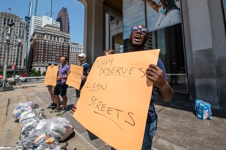 """Former sanitation worker Terrill Haigler, also known as """"Ya Fav Trashman,"""" leads a protest at the Municipal Services Building to demand leaders address the city's trash """"epidemic."""""""