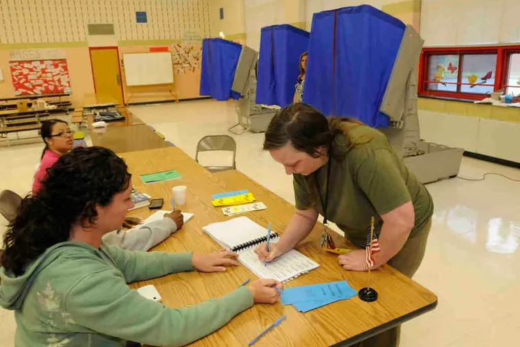 Rosanne Dunn of Bensalem was one of the few voters to sign up to cast her ballot at Cornwells Elementary School in Bucks County. She was the 92d person out of 1,922 registered voters as of 1 p.m. Tuesday.