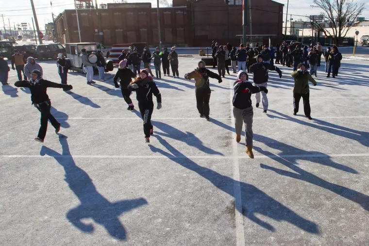Members of the Hegeman String Band dance in very uncomfortable temperatures during a Sunday rehearsal on Snyder Street.
