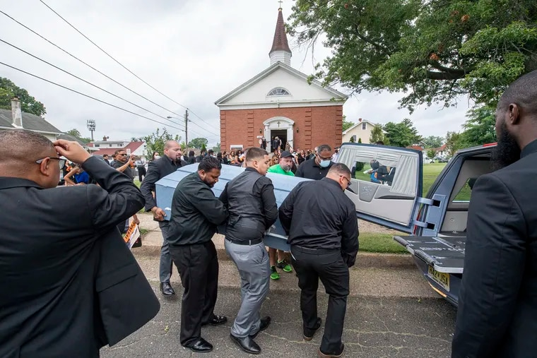 Padro Sr., left, carries his son's casket with pallbearers at the end of a memorial service to celebrate the life of David Padro Jr. on Thursday, July 29, 2021., at the First Spanish Baptist Church in Pennsauken Township, N.J. David Padro Jr. was shot and killed outside Pat's Steaks in Philly on July 22, 2021.