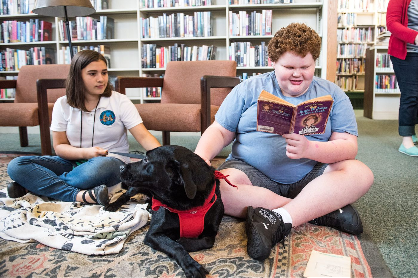 'The dog doesn't care if you mess up some words': Why Philly kids are reading to pooches