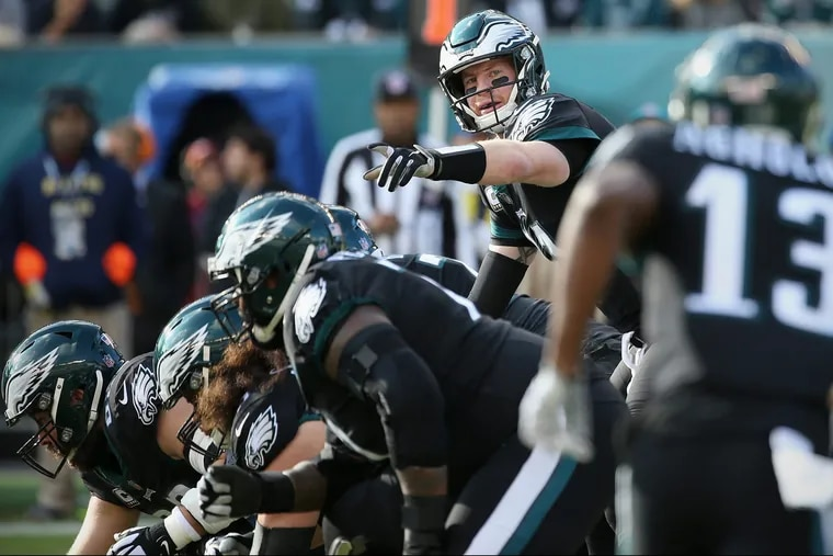 Eagles quarterback Carson Wentz (11) directs his teammates before a snap in a game against the New York Giants at Lincoln Financial Field in South Philadelphia on Sunday, Nov. 25, 2018. The Eagles won 25-22. TIM TAI / Staff Photographer