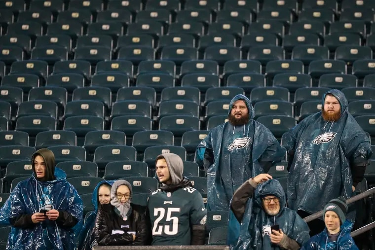Fans wear rain gear before the Eagles take on the New York Giants at Lincoln Financial Field on Monday, Dec. 9, 2019.