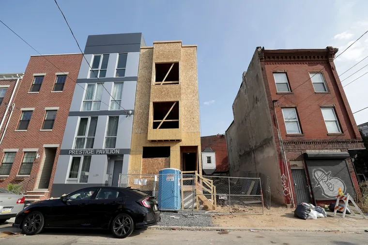 Partners Bryheim Murray and Kyle Easley bought the property where a rowhome is now rising at 627 W. Oxford St, in North Philadelphia. They bought it for $37,500 from an estate and resold it for $155,000 just 19 days later. One of the heirs said it was sold despite her opposition.