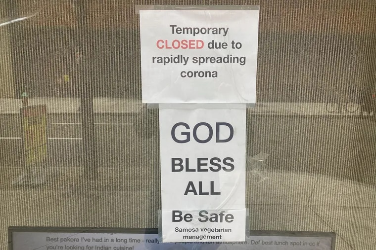 A sign on the door of Samosa Vegetarian, 1214 Walnut St., explains that the restaurant is closed because of the coronavirus.
