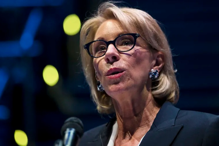 FILE - In this Sept. 17, 2018 file photo, Education Secretary Betsy DeVos speaks during a student town hall at National Constitution Center in Philadelphia.  President Donald Trump's school safety commission is proposing a rollback of Obama-era guidance that was meant to curb racial disparities in school discipline. The commission was led by DeVos and made dozens of policy recommendations in a report released Tuesday. Trump created the panel in March following the deadly school shooting in Parkland, Florida.  (AP Photo/Matt Rourke)