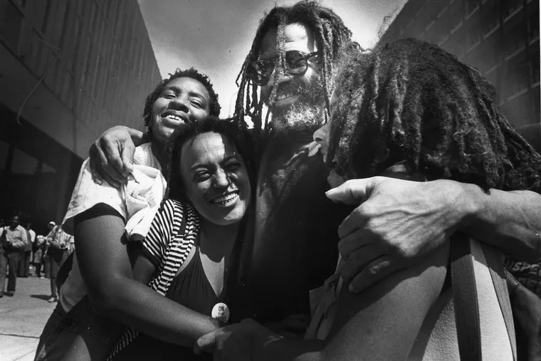 MOVE founder John Africa gets a hug from members including Pam Africa (in striped blouse) outside Federal court in Philadelphia on July 22, 1981 after he was acquitted of gun-related charges.