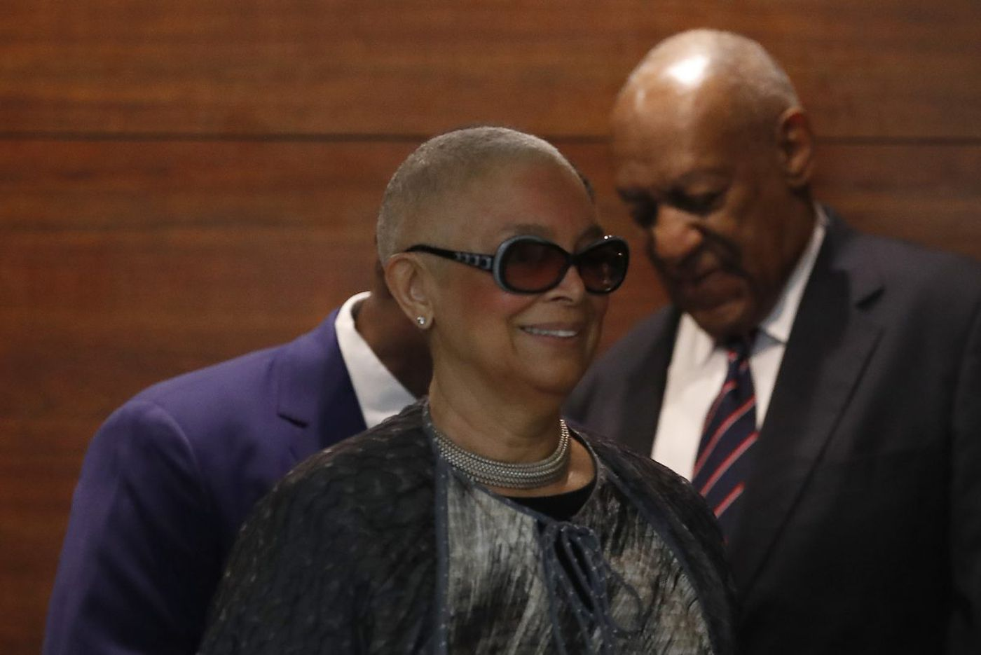 Bill Cosby's wife is not at his trial. But Camille Cosby's presence looms