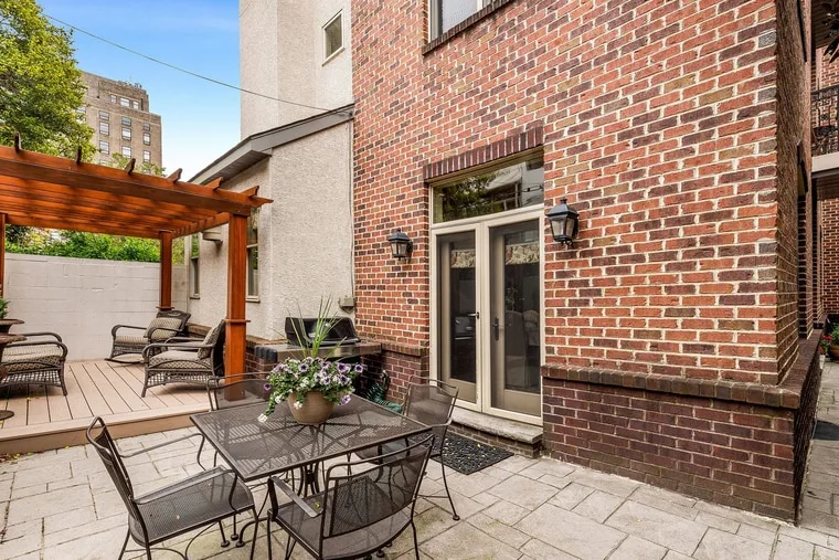 The large brick contemporary home in the neighborhood also known as Southwest Center City had land on three sides.