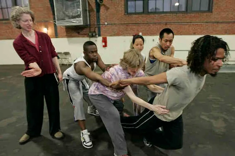Choreographer Leah Stein (left) directs her dancers (from left) Jamil Kosoko, Josie Smith, Michelle Tantoco, Makoto Hirano and Jumatatu Poe. The show is part of Hidden City Festival.