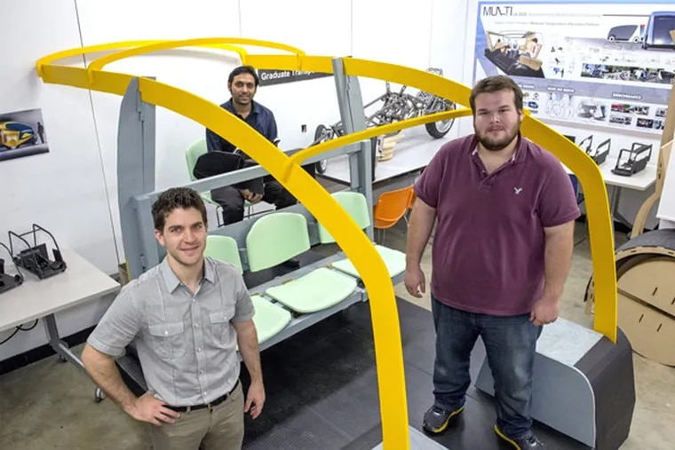 Art Center College of Deisgn Transportation Design graduate students (from left) Cody Casale, Tejsh Goregaonkar, and Ali Kaldrim stand with their NYC Taxi design. (Kyusung Gong/Orange County Register/MCT)