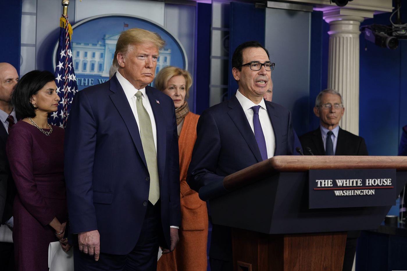 Treasury Secretary Steven Mnuchin speaks during a press briefing with the coronavirus task force, at the White House as President Donald Trump looks on.