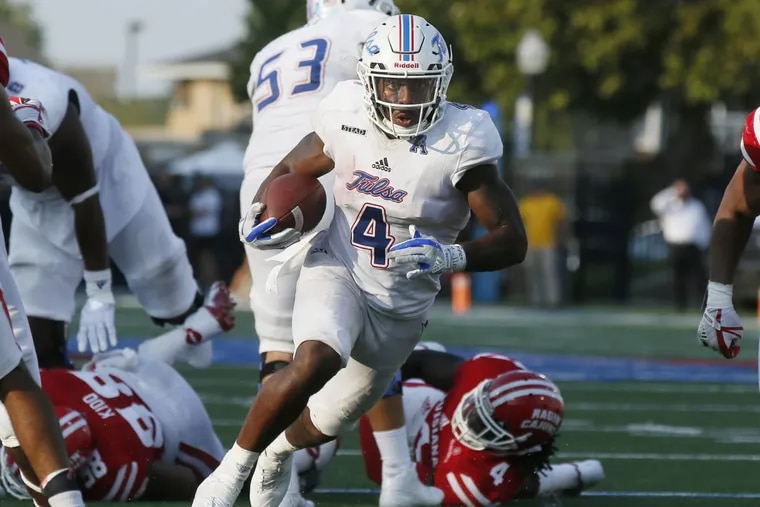 Tulsa running back D'Angelo Brewer (4) carries in the fourth quarter of an NCAA college football game against Louisiana-Lafayette in Tulsa, Okla., Saturday, Sept. 9, 2017. Tulsa won 66-42. (AP Photo/Sue Ogrocki)