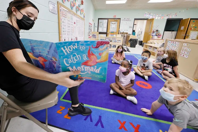 Assistant teacher Erin Jonas reads to a pre-kindergarten class at the Northeast YMCA on Knights Road in Philadelphia.