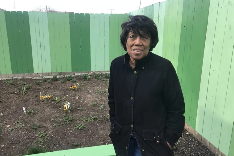 Elmira Smith in the community garden she and her neighbors created in Kensington. It is now threatened by an impending sheriff's sale.