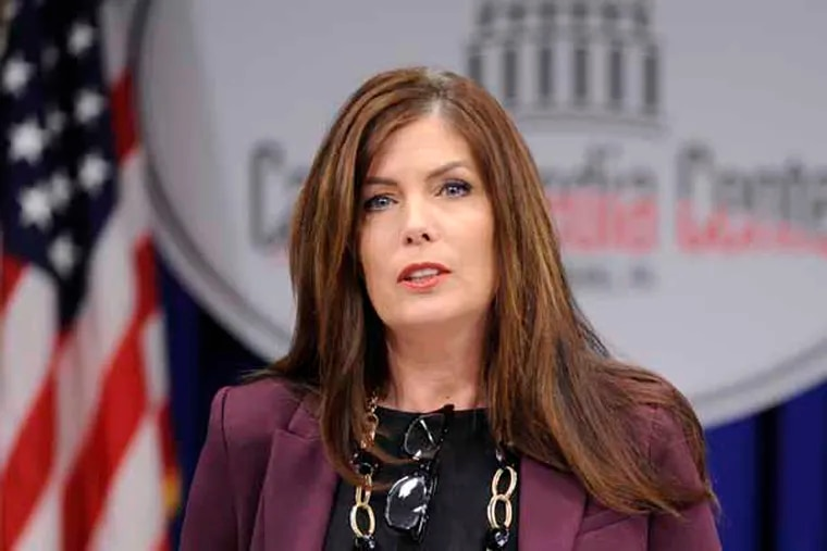"""Pennsylvania Attorney General Kathlen Kane conducts a news conference at the Capitol announcing charges against a former state Senate leader and seven others in what they called a """"pay to play"""" case involving the Pennsylvania Turnpike Thursday, March 13, 2013 in Harrisburg, Pa. (AP Photo/Bradley C  Bower)"""