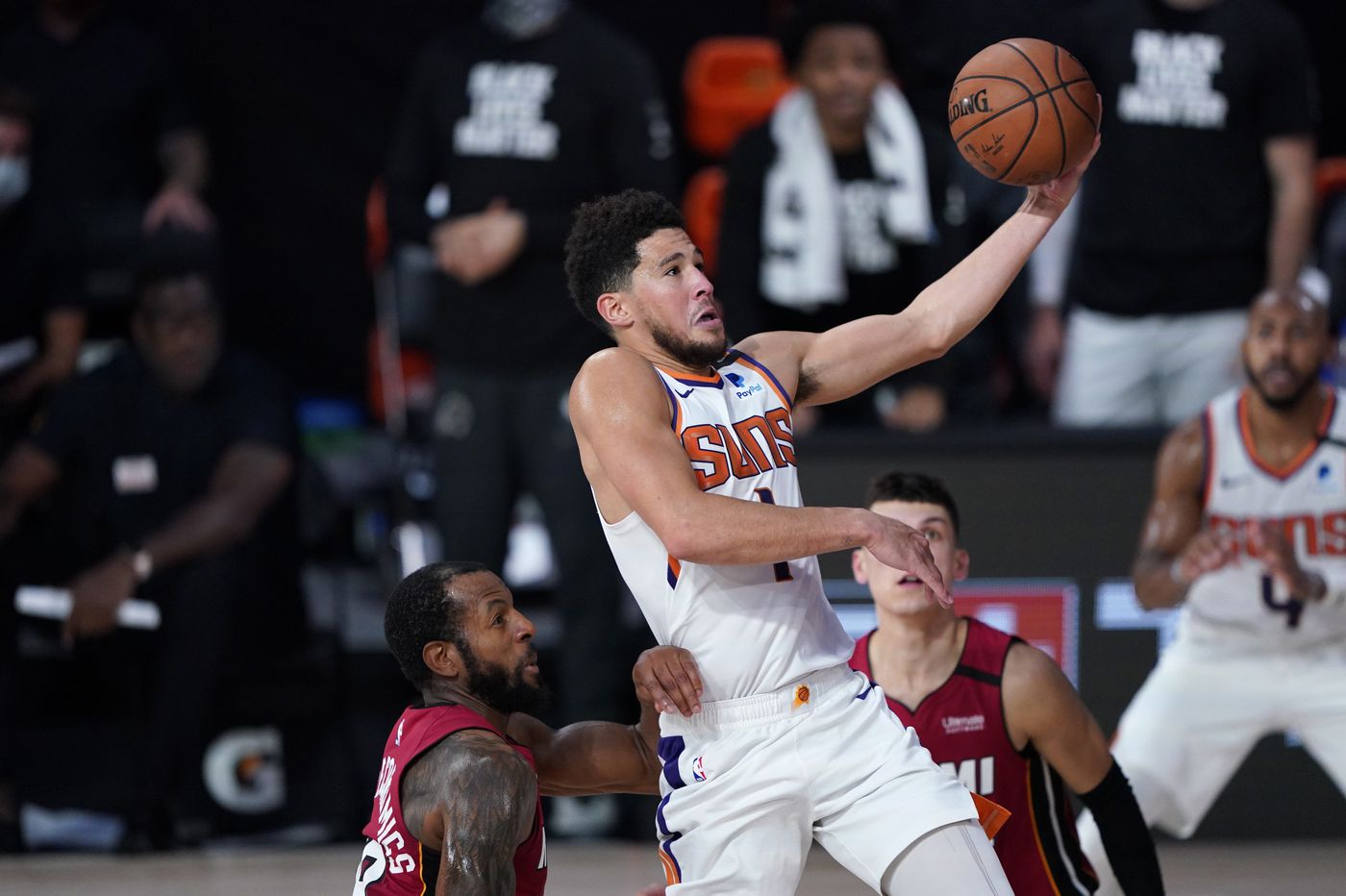 Sixers look to slow down Phoenix's sizzling Devin Booker