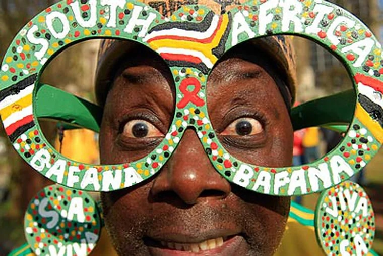 South African fans are ready for their team to play Mexico in the opening game of the World Cup. (Hassan Ammar/AP)