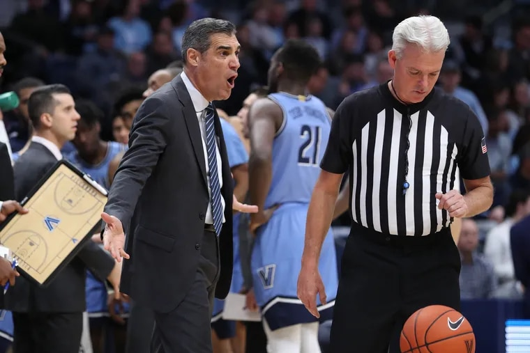 Coach Jay Wright, left, of Villanova expresses displeasure with a call during their game against Penn on Dec. 4, 2019 at the Finneran Pavilion at Villanova University