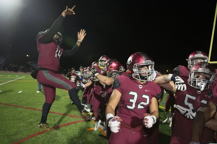 St. Joe's Prep players celebrate their 17-3 victory over La Salle in the Catholic League 6A championship on Nov. 10.