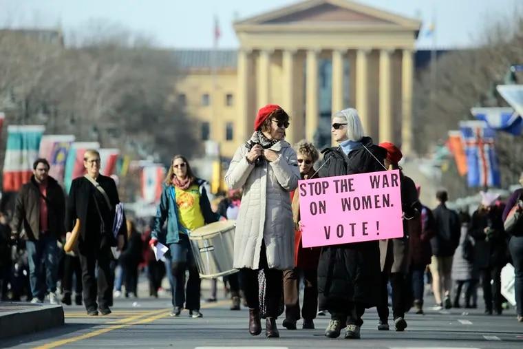 Linda Lelii Of Elkins Park (left) and Dianne Chambless of Philadelphia leave the Womens March on Philadelphia on January 20, 2018.