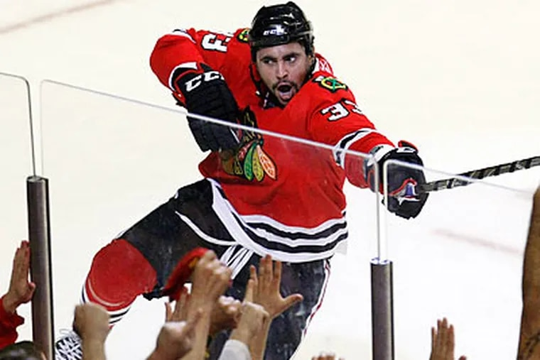 The Blackhawks are aiming for their first Stanley Cup since 1961. (Charles Rex Arbogast/AP)