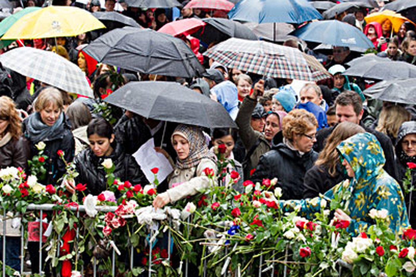 Norwegians raise voices to protest killer
