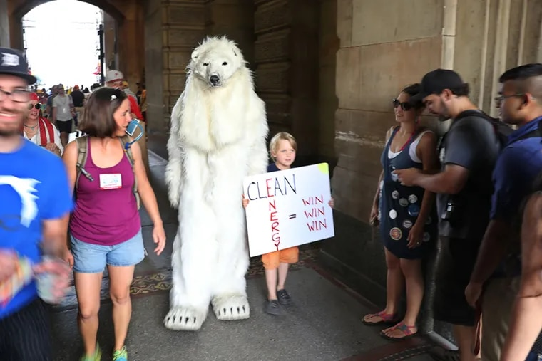 A human being dressed as a polar bear makes their way through the south City Hall entrance to the main courtyard just before the start of the June 2016 March for Clean Energy in Philadelphia. The march featured climate activists, students, labor union members, and anti-war advocates. Participants are calling for a ban on fracking, an end to building fossil fuel infrastructure, and a commitment to building a 100 percent renewable energy economy. MICHAEL BRYANT / Staff Photographer