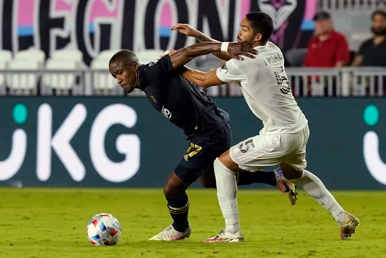 Union forward Sergio Santos, left, tried to keep the ball from Inter Miami defender Nicolas Figal during the second half of Sunday's game.