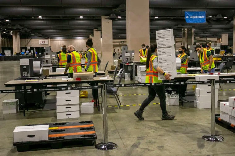 Workers on the hall floor at the Pennsylvania Convention Center counting Philadelphia mail ballots on Nov. 4.