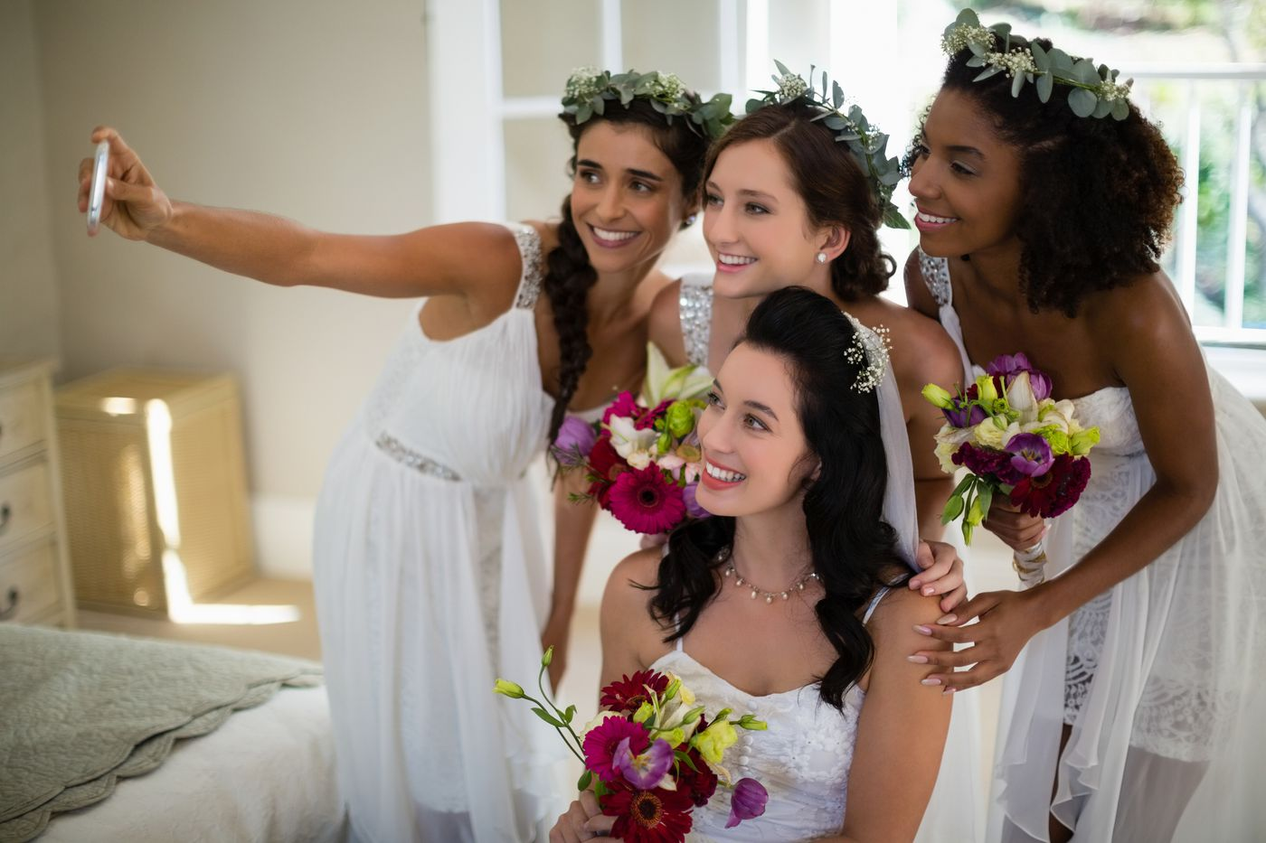 Matching T-shirts, hikes in Colombia, custom Snapchat filters: The changing standards of the wedding industrial complex